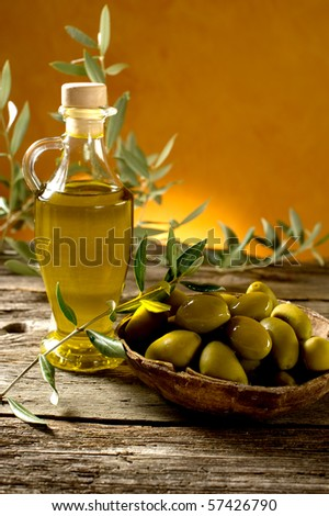 olive with olive oil - stock photo