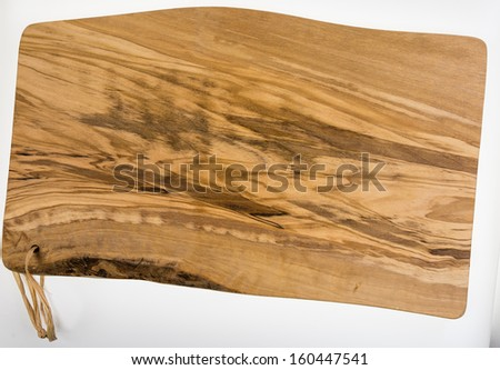 Olive wood cutting board - isolated on white  - stock photo