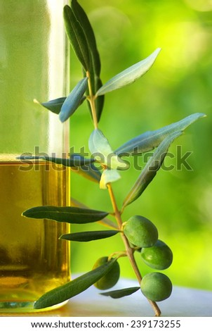 Oliveoil and olives.  - stock photo