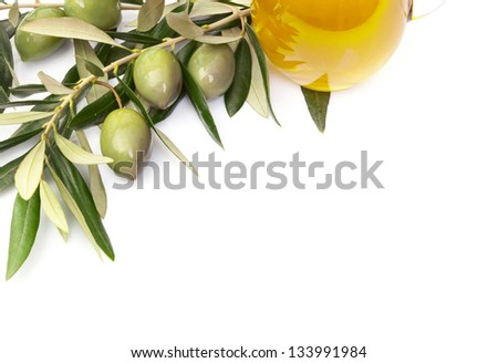 Olives and a bottle of olive oil isolated on white background