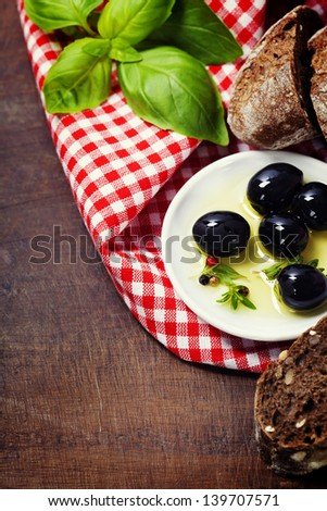 Olives and Olive Oil on an old tablel - italian food concept - stock photo