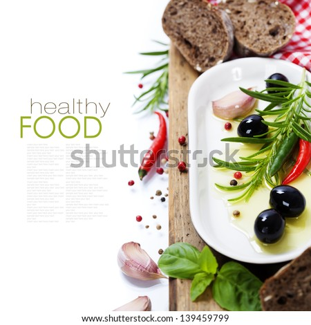 Olives and Olive Oil on an old tablel - italian food concept (with easy removable sample text) - stock photo