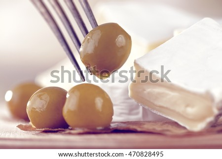 olives and white cheese in a large kitchen