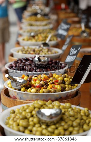 Olives being sold at a traditional farmers street market - stock photo