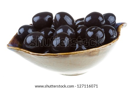 Olives black watered with olive oil in a bowl isolated on a white background - stock photo