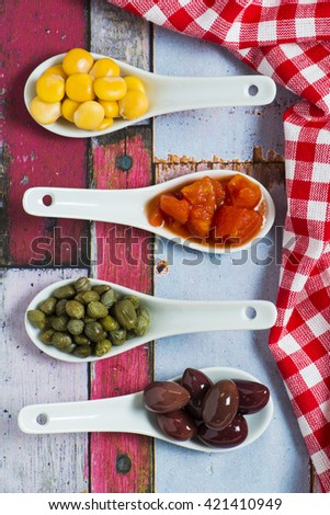 Olives, Capers ,Lupin Beans and chopped tomatoes  - stock photo