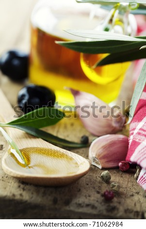 Olives, garlic and Olive Oil on old tablel - stock photo