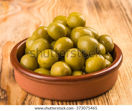 olives in classic mud pie - stock photo