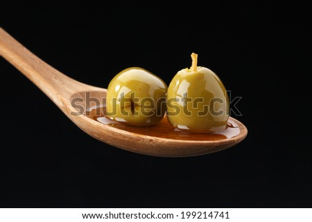 Olives in Spoon  - stock photo
