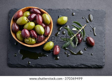 Olives on a graphite board - stock photo