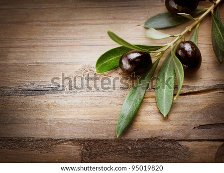 Olives over Wood Background - stock photo
