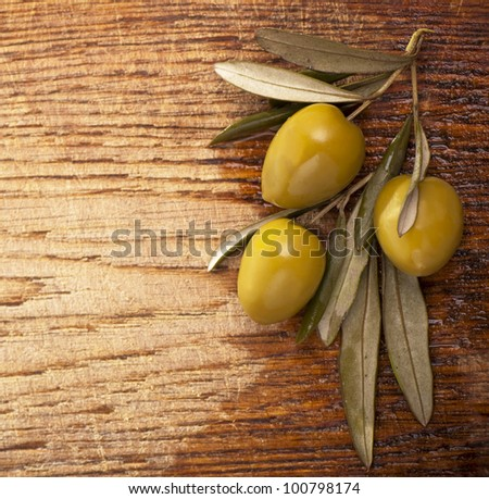Olives over Wooden Background. With sample text
