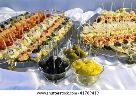 Olives, patty-pan and  light snacks. - stock photo