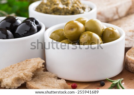 olives, pesto, fresh vegetables and ciabatta, close-up - stock photo