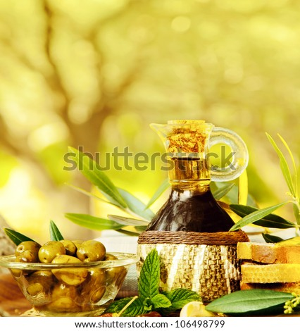 Olives still life, fresh food in garden of olive trees, farm land at countryside of Lebanon, homemade healthy olive oil and bread, harvest time - stock photo