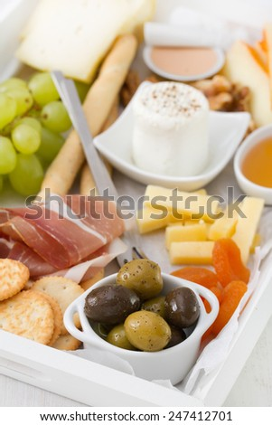 olives with fresh cheese, honey, nuts and grape - stock photo