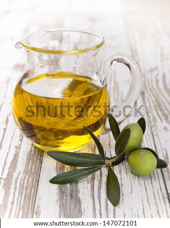 Olives with leaves on a wooden background.