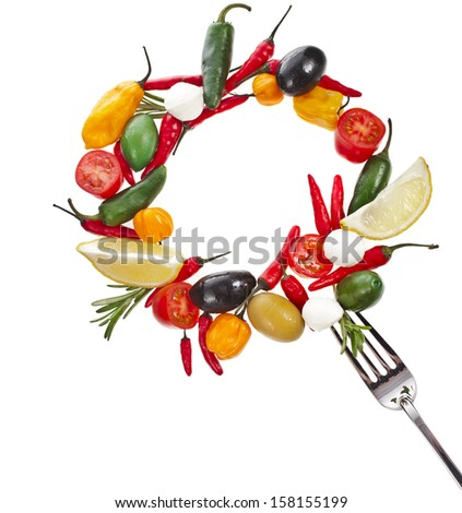 olives with vegetables and herb spice falling in fork isolated on a white background  - stock photo