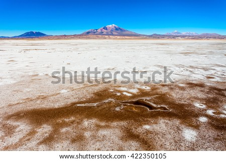 Ollague stratovolcano in the Andes, on the border between Bolivia and Chile. - stock photo
