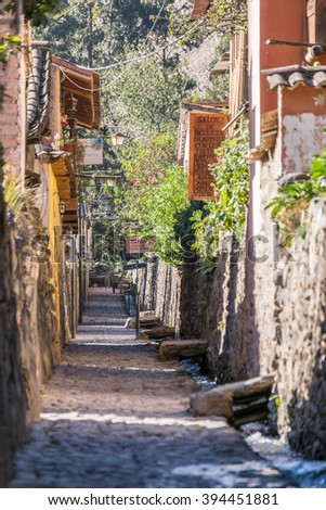 Ollantaytambo, Urubamba/Peru - circa June 2015: Old narrow street and brick buildings in Ollantaytambo Inca town