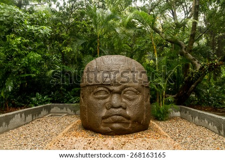 Olmec big basalt head - Villahermosa, Mexico - stock photo