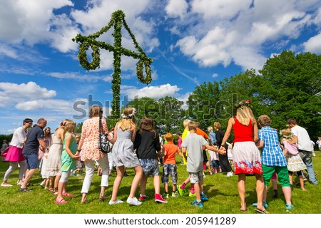 OLOFSTROM, SWEDEN - JUNE 20: People dancing around the may pole, a swedish tradition at midsummer in Blekinge on June 20, 2014. - stock photo