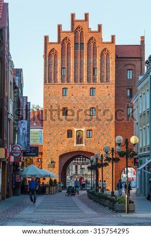 "OLSZTYN, POLAND - July 23, 2015: The Upper Gate (polish ""Wysoka Brama"") in Olsztyn old town built in the 14th century.  - stock photo"