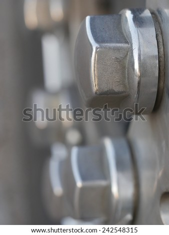 olts and nuts on a tire - stock photo