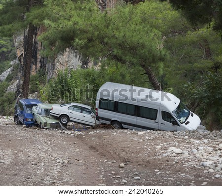 OLYMPOS, TURKEY - OCTOBER 14, 2009: Crashed cars after flood disaster in Olympos, Turkey. - stock photo
