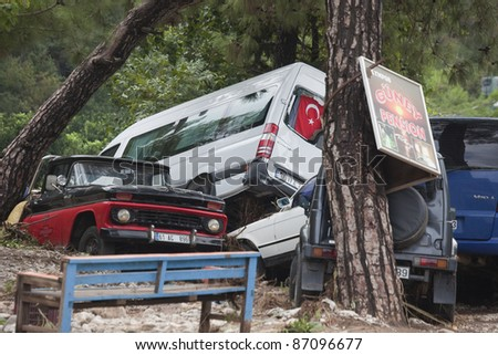 OLYMPOS, TURKEY - OCTOBER 14: Crashed cars in the woods after flood disaster on October 14, 2009 in Olympos, Turkey, Asia. The floods swept away about 50 cars. - stock photo