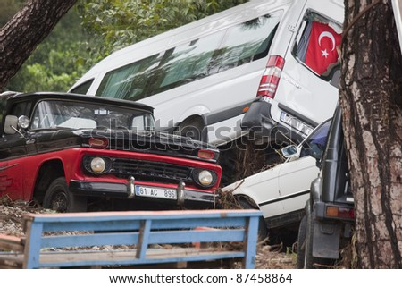 OLYMPOS, TURKEY - OCTOBER 14: Crashed cars in the woods after flood disaster on October 14, 2009 in Olympos, Turkey, Asia. The floods destroy roads and houses and swept away about 50 cars. - stock photo