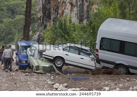 OLYMPOS, TURKEY - OCTOBER 14, 2009: Crashed Cars in Turkish Village after Flood Disaster in Olympos, Turkey. - stock photo