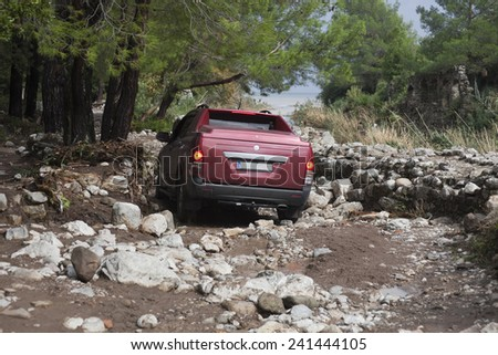 OLYMPOS, TURKEY - OCTOBER 14, 2009: Off-Road vehicle on narrow dirt road after flood disaster in Olympos, Turkey. - stock photo