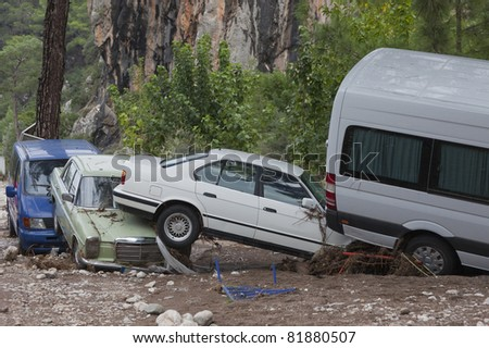 OLYMPOS, TURKEY - OCTOBER 14: Olympos, a famous holiday spot was hit by floods on October 14, 2009 in Olympos, Turkey. The floods swept away about 50 cars parked on the road. Roads were destroyed. - stock photo
