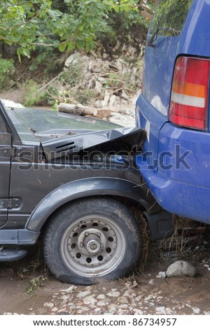 OLYMPOS, TURKEY - OCTOBER 14: Rear end collision of two cars after flood disaster on October 14, 2009 in Olympos, Turkey, Asia. The floods swept away about 50 cars. - stock photo