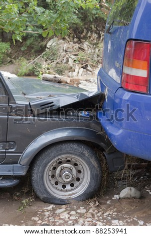 OLYMPOS, TURKEY - OCTOBER 14: Rear end collision of two cars after flood disaster on October 14, 2009 in Olympos, Turkey, Asia. The floods destroy roads and houses and swept away about 50 cars. - stock photo