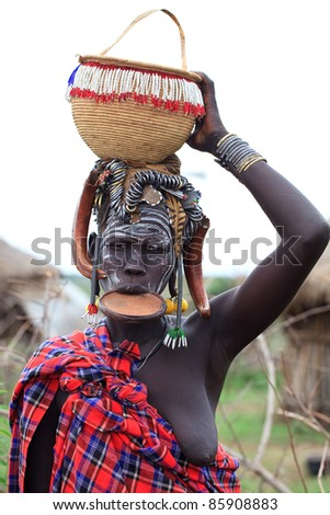 OMA VALLEY, ETHIOPIA - AUG 11: Mursi woman posing in the village,the ethnic groups in the The Omo valley Could disappear Because of Gibe III hydroelectric dam on Aug 11, 2011 in Omo Valley, Ethiopia. - stock photo