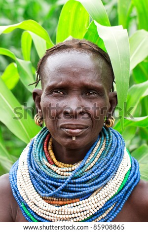 OMA VALLEY, ETHIOPIA - AUG 14: Nyangatom woman posing in the village,the ethnic groups in the The Omo valley Could disappear Because of Gibe III hydroelectric dam. on Aug 14, 2011 in Omo Valley, Ethiopia.