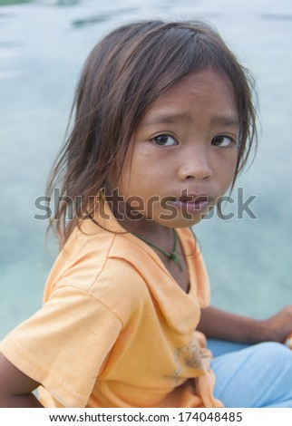 OMADAL ISLAND, SABAH, MALAYSIA - JANUARY 29 : Unidentified Sea Gypsies girl on January 29, 2012 in Sabah, Malaysia. The Sea Gypsies are sea nomads that move from one place to another.