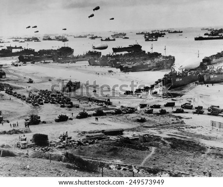 Omaha Beach after D-Day. Protected by barrage balloons, ships delivered trucks loaded with supplies. June 7-10, 1944, World War 2. Normandy, France, World War 2. - stock photo