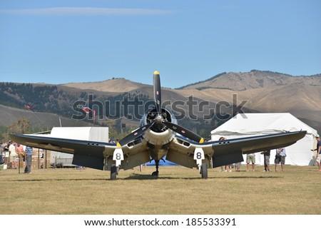 "OMAKA-APRIL 03:American Corsair aircraft on the display during the royal New Zealand air force ""Omaka airshow"" on April 03, 2013 in Blenheim New Zealand - stock photo"