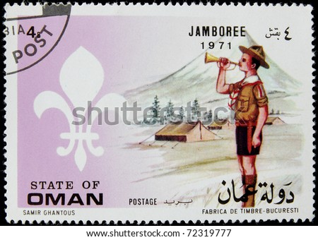 OMAN - CIRCA 1971: A post stamp printed in Oman shows scout with a horn, circa 1971 - stock photo