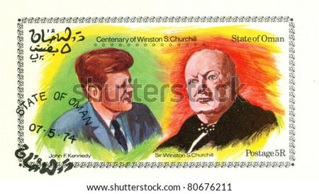 OMAN, CIRCA 1974: A stamp printed in Oman of Centenary of  Winston Churchill with John F. Kennedy, circa 1974 - stock photo