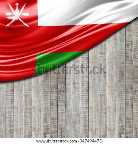 Oman flag of silk with copyspace for your text or images and wood background