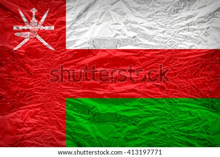 Oman flag pattern overlay on floyd of candy shell, vintage border style - stock photo