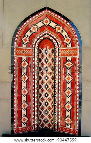 Oman Muscat. Islamic architectural artwork arch wall background in the Al Qubrah Mosque in Muscat, Oman. - stock photo