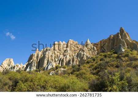 Omarama Clay Cliffs, These are 1000's of years old and a major landmark in the region comprising huge sharp pinnacles and ridges with deep, narrow ravines, Mackenzie Country South Island, New Zealand. - stock photo