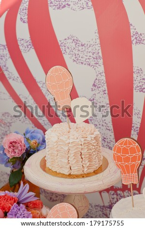 Ombre ruffle cake with cookie in shape of balloon on top. Balloons wedding party - stock photo