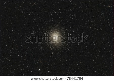Omega Centauri is one of the few globular clusters visible to the naked eye and appears about as large as the full Moon. - stock photo