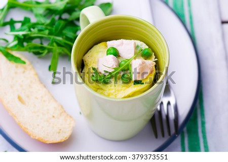 omelet in a  mug prepared in microwave . horizontal permission. selective focus - stock photo